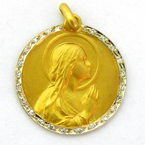 medalla ave manos con orla de brillantes oro amarillo